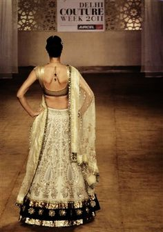 A lengha. Love the champagne and black color combo.