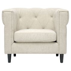 Bring stately elegance to your living room or parlor with this tufted arm chair, featuring linen upholstery and tapered birch wood legs.   ...