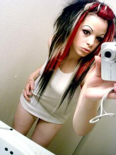 red black and blonde hair; terrible extensions, but nice color combo.