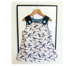 LOVE this! Aeroplane Pinafore Dress - Handmade in colourful print fabric, perfect for junior aviators and future engineers!