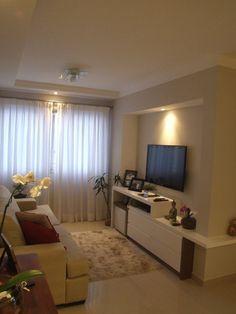 O nicho na parede me agrada bastante para colocar a Tv e aproveitar mais o espaço !