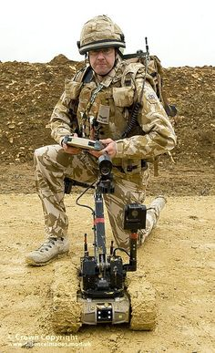 A soldier operates a Dragon Runner Bomb Disposal Robot at a Counter IED (CIED) facility demonstration at RAF Wittering.