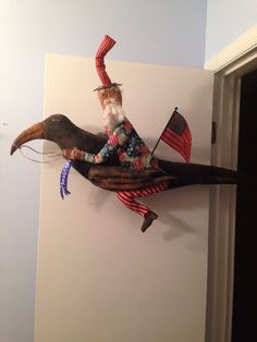 Primitive Uncle Sam Doll On Large Crow