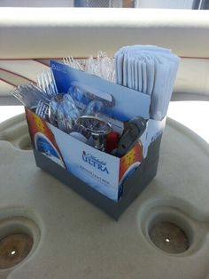 Red-Neck Utensil Caddy. We use this one on our boat & we have another one we use outside on the patio. Just reinforce any 6 pack container with duct tape & insert forks, knives, napkins, bottle opener, etc. & your good to go-