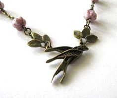 Swallow necklace jewelry with leaves and light purple