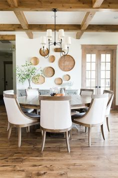 Farmhouse Dining Room with Rustic Wood Beans and Large Round Wooden Table Dining Room table Dining Room Walls, Dining Room Design, Dining Area, Kitchen Dining, Dining Chairs, Living Room, Kitchen Booths, Beige Dining Room, Kitchen Seating