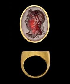 A HELLENISTIC GOLD AND GARNET INTAGLIO RING WITH ROYAL PORTRAIT OF A PTOLEMAIC RULER, PROBABLY PTOLEMY IX, SOTER II LATE 2ND/EARLY 1ST CENTU...