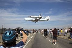 The space shuttle Endeavour sits atop the Shuttle Carrier Aircraft as it lands in Los Angeles on Sept 21.