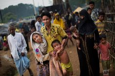 An exhausted Rohingya helps an elderly family member and a child as they arrive at Kutupalong refugee camp after crossing from Myanmmar to the Bangladesh side of the border, in Ukhia, Tuesday, Sept. 5, 2017. The man said he lost several family members in Myanmar. Tens of thousands of Rohingya Muslims, fleeing the latest round of violence to engulf their homes in Myanmar, have been walking for days or handing over their meager savings to Burmese and Bangladeshi smugglers to escape what they…