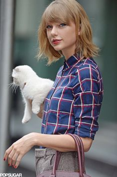 Taylor Swift and her kitty cat headed out in NYC on Thursday.