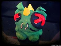 trash tlk gang. This is Rex! The reptile of the group. Using air dry clay, acrylic paint and steel piercings.
