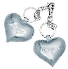 """Just Married Heart Key Rings Savor the wedding bliss with these bride and groom silver leather heart keyrings! Set of 2, one printed with """"bride"""" and one with """"groom"""". Perfect for a bridal shower gift!"""