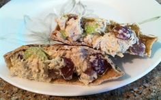 Chicken salad  - E meal I use Joseph's Pita Bread (low carb option)  2 (12.5 oz) cans of chicken, drained [or 3 cups diced cooked chicken] 3/4 cup light mayonnaise 1 cup red grapes, halved (You may want to go light on the grapes for THM but this is the only time I eat them) 2 stalks celery, finely diced 1 teaspoon dill weed