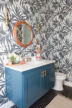 Pool Bathroom Reveal Styled By Cost Pus World Market. Wallpaper Bathroom, Wallpaper ideas, palm wallpaper, green paint, bathroom styling ideas, bathroom ideas, wood mirrors, bathroom pendants, pool bathroom, pool baths