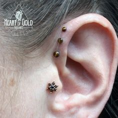 Triple Forward Helix and Tragus Piercings.  Jewelry by NeoMetal and BVLA.