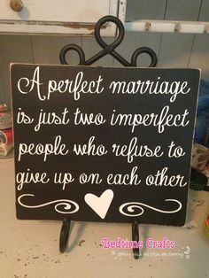 Quote reads A perfect marriage is just two imperfect people who refuse to give up in each other    Sized 12x10 inches, about an inch thick. **Stand
