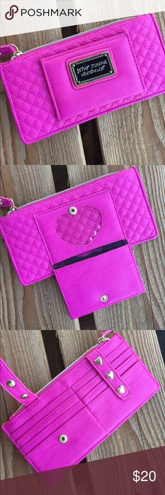 Betsey Johnson I.d. Holder Pink Betsey Johnson I.d. Holder for wallets or purses. No compartments on inside of main pocket. 10 slots for cards/I.d. 7.5 inches wide, 3.75 inches tall. *NOT A WALLET* Betsey Johnson Bags Wallets