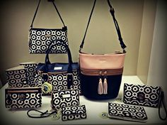 Beautiful blend of linen and jeather handbags, snap wallets, crossbodies, wristlets and tech covers.
