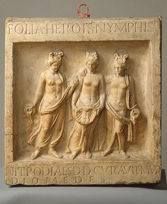 Bas relief of the Nymphs of Nitrodi.   Center one is holding a shell to receive and distribute water.   The two on the sides hold water vessels.