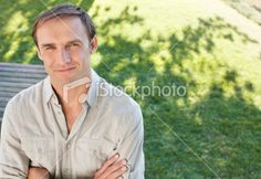 Portrait of happy mid adult man in park Royalty Free Stock Photo
