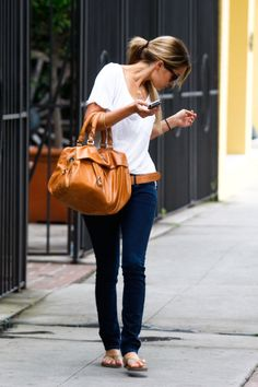 Love the classic white t-shirt and jeans look, and that color bag is amazing!