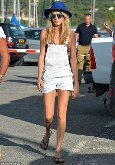 Always photogenic: The London native showed off lean legs as she walked in flip flops (wit...