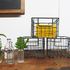 I have one similar wire basket that I love for storage. I need more to hold veggies in the kitchen... $35