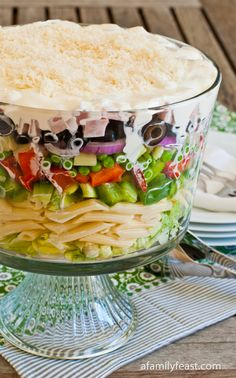 This chopped salad with pasta is full of delicious, fresh vegetables – crisp lettuce, green and red bell peppers, peas, celery and red onion.  Chunks of cooked Virginia ham and pasta are added, and then all of the ingredients are tossed with a creamy dressing made from mayonnaise, sour cream, champagne vinegar, Dijon mustard and other seasonings.  It's a really delicious combination of fresh flavors!