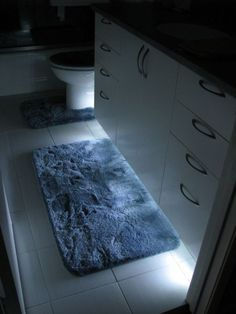 Bathroom safety, anyone? LED tape lights make great under-vanity nightlights. #DiaryofaDIYer