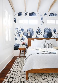 Ways To Use That Room Below Your Stairs This Gorgeous Eclectic Blue Master Bedroom Was A Huge Makeover For My Client's Renovated Home. I Used Floral Decals On The Wall And Coastal Casual Home Accessories Like A Gold Sconce, Soft Linens, And A Textured Rug Blue Master Bedroom, Cozy Bedroom, Home Decor Bedroom, Bedroom Furniture, Bedroom Ideas, Bedroom Neutral, Bedroom Rugs, White Bedroom, Bedroom Wall Decals