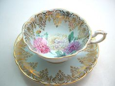 Antique Paragon Tea cup And Saucer,  Blue with gold, Gold scroll on baby blue tea cup set.