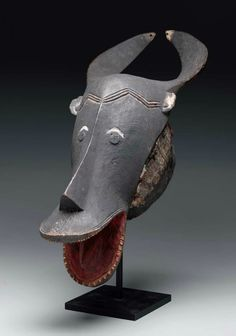 Africa | Helmet mask ~ gye ~ from the Guro people of Ivory Coast | Wood, paint and sheet metal | Mid 20th century