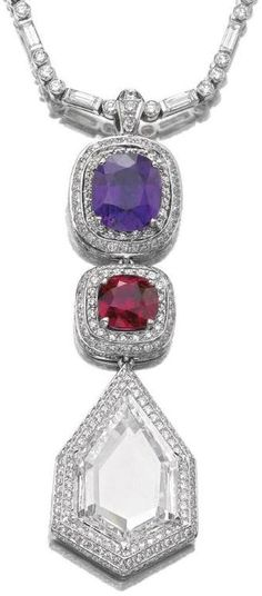 Sapphire, ruby and diamond pendent necklace.     The detachable pendant designed as an articulated line set with a cushion-shaped purple sapphire weighing 7.04 carats, a similarly cut ruby weighing 4.47 carats, and a modified kite portrait-cut diamond weighing 11.48 carats, each framed and bordered by a triple row of brilliant-cut stones, to a necklace composed of alternating brilliant-cut and baguette diamonds, length approximately 520mm.     Sotheby's.