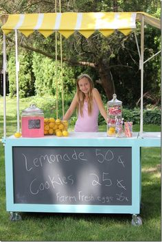 Lemonade cart with striped canopy from https://sawdustgirl.com.