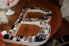 """Monogram Gift -- DIY (for a couple or their kids) this would be fun to do for all my girls. They'd all have the """"E"""" but I could put different cute pictures and maybe tie a ribbon of their favorite color. :)"""