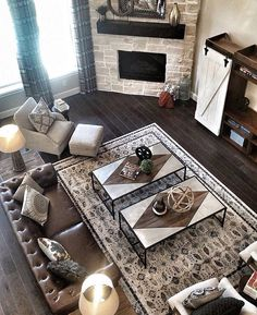 Love the idea of a corner fireplace. And I love those floors and the stone they used for the fireplace.