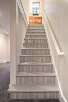 Clever idea to give stairs a 'wow' factor using wallpaper. Any design could be used