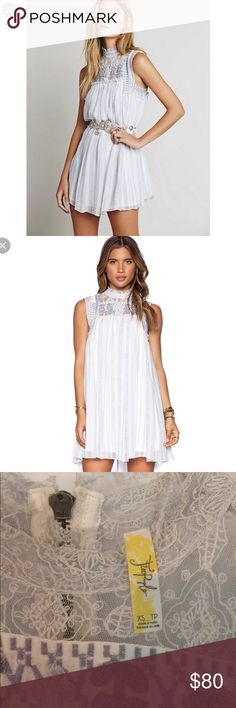 free people penny georgette babylon dress ⭐️ beautiful & rare free people dress in ivory w/ purple detailing 🌷  xs fit (would fit up to a small). get it while it's here ladies! Free People Dresses Mini
