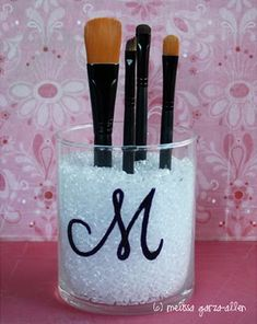 This DIY MAKEUP BRUSH HOLDER would be perfect on any vanity!