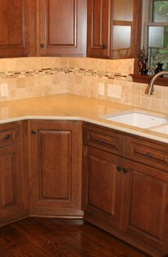 Kitchen backsplash with glass tile I like like I did around the whirlpool tub. But an equally nice option for kitchen, if you don't want to invest a huge sum in a fashion color that will need to be changed,