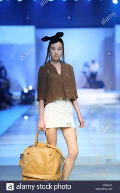 A model poses at Camilla Wellton fashion show during the Shanghai 2012 Spring/Summer Fashion Week in Shanghai, China, 27 October 2011. Stock Photo Camilla, Editorial Photography, Shanghai, Spring Summer Fashion, Fashion Show, Glamour, Poses, Stock Photos, Female