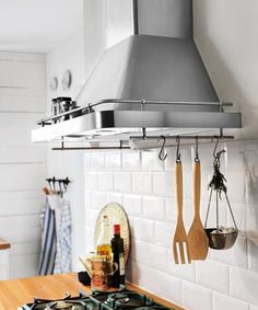 This IKEA Datid hood, about $680, does double duty with a built-in shelf and rails to hold spices and utensils. I Photo: Courtesy of IKEA | thisoldhouse.com