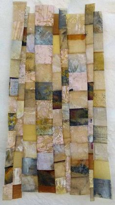 Sue Hotchkis - Mono prints onto brown paper, waxed and then machine stitched together.