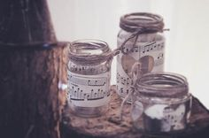 Music sheet jam jar lanterns for a romantic Flower Fairy inspired wedding with gypsophila flower crown and woodland themed wedding reception // The Natural Wedding Company