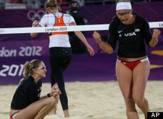 Kerri Walsh, left, and Misty May-Treanor, right, of US celebrate after victory over Netherlands during the Beach Volleyball match at the 2012 Summer Olympics, Saturday, Aug. 4, 2012, in London