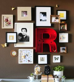 I love the arrangement of these frames...look at the little frame on top of a big one!  Very cute.