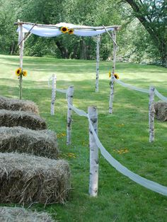 Love the hay idea for seats! And the branches with white fabric for the isles... But maybe add simple yellow n white flowers to branches.
