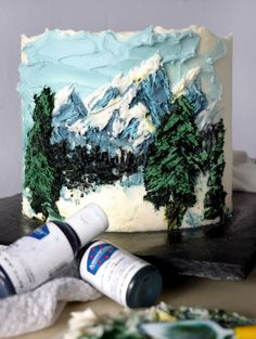 In this palette knife painted cake tutorial, you'll learn to paint on a cake with buttercream and create a beautiful winter mountain scene. Plus, I include my recipe for a delicious salted caramel hot chocolate cake. Come for the recipe or come for the cake painting tutorial, either way this is the best dessert of the winter! #winter #cake #painted #paletteknife #saltedcaramel #hotchocolate