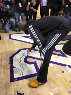 Kobe Bryant signed his name on his numbers, 8 & 24, on the Staples Center floor after his 60-point encore performance in the final game of his 20-year NBA career.