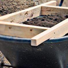 Compost screen that fits over a wheelbarrow. Use to remove sticks and rocks from your compost
